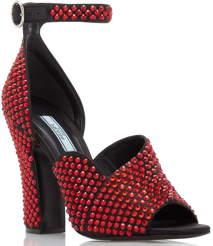 Rows of ruby-red crystals add a darkly romantic look to a silken pump featuring a curvy crossover vamp, substantial heel and slender oval buckle at the ankle