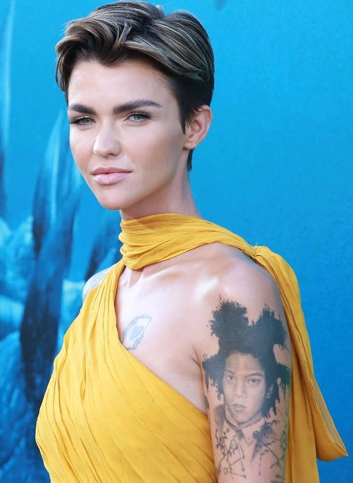Ruby Rose has a gigantic tattoo of graffiti artist Jean-Michel Basquiat on her upper left arm