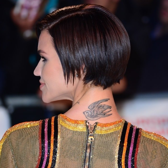 Ruby Rose's swallow neck tattoo representing freedom