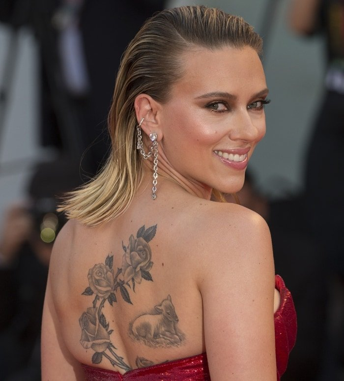 Scarlett Johansson has a massive black-and-white tattoo of a branch of roses on the right side of her back