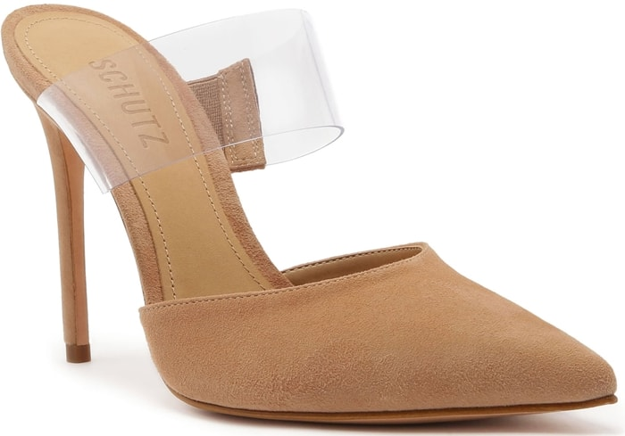 A trend-savvy transparent strap enhances the leg-lengthening effect of a pointy-toe mule lifted by a willowy stiletto heel