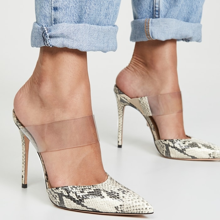 This snake-embossed leather mule showcases a polished pointed toe, clear vinyl strap and stiletto heel, perfect for elevating an office-to-out situation