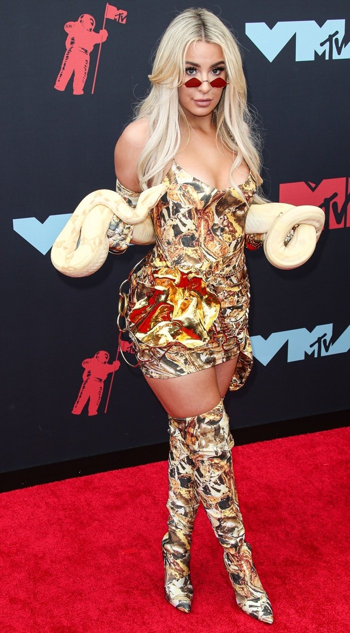 Tana Mongeau poses with a Boa constrictor at the 2019 MTV Video Music Awards