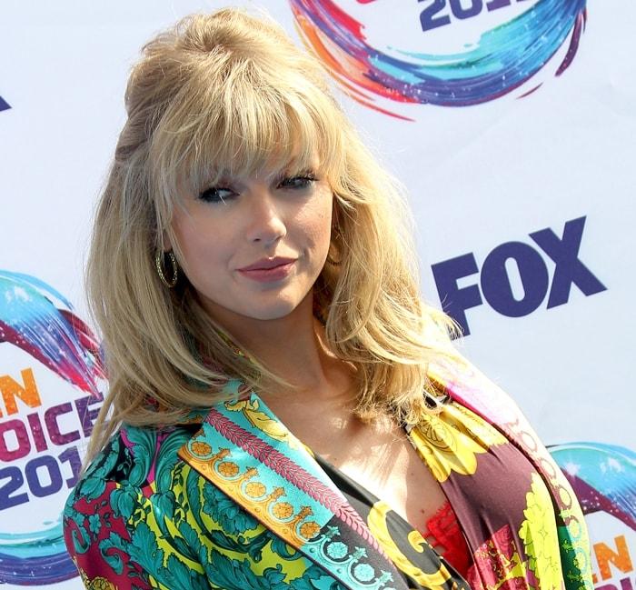 Taylor Swift accessorized with Misahara Zeta diamond hoops