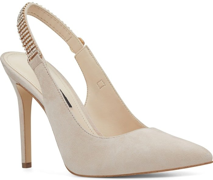 The classic slingback pump gets a glam update as this nude pointy-toe stiletto Tenza adorned by crystal mesh along the strap