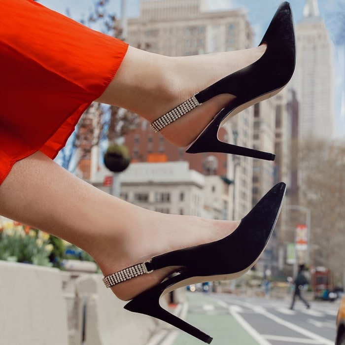 The classic slingback pump gets a glam update as this pointy-toe stiletto Tenza adorned by crystal mesh along the strap