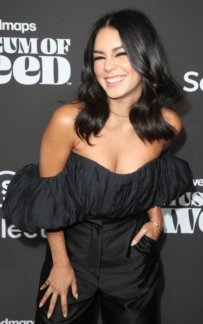 Vanessa Hudgens's pleated bodice is designed as an off-the-shoulder style with dramatic puffed sleeves and a corseted fit