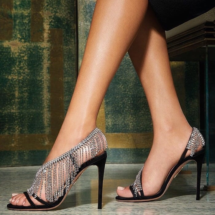 Crafted from black leather and suede, these Wild Fringe Crystal 105mm sandals feature an open toe, a strappy design, fringe details, crystal embellishments and a high stiletto heel