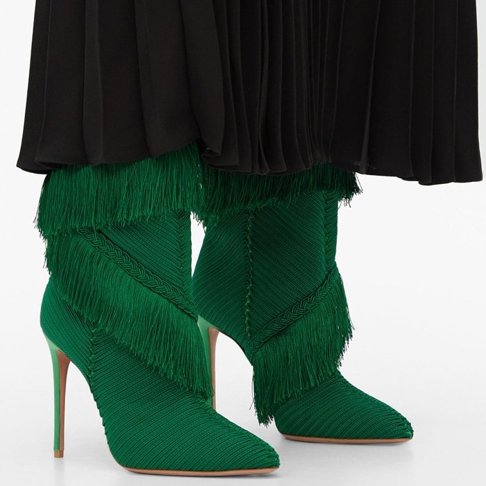 Crafted in Italy from luxurious satin in elegant couture green, this eye-catching pair features a sleek, pointed toe and layers of fringe that dance with every step