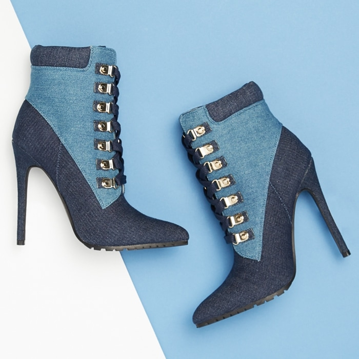 A pointed-toe bootie featuring a faux-leather trim, stiletto heel, decorative side zipper, and lace-up closure