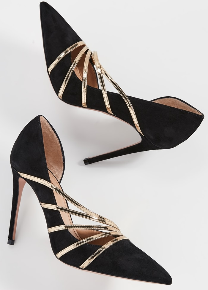Sleek point-toe pumps feature a d'Orsay cutaway silhouette with metallic leather straps