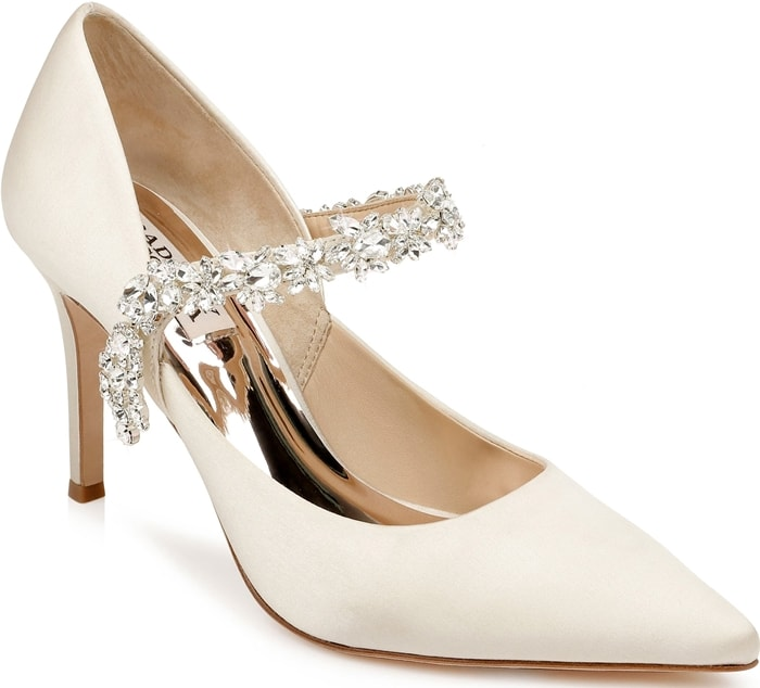 A mix of crystals twinkle and shine at the strap of this glamorous pointy-toe satin pump lofted by a slimmed-down, tapered heel