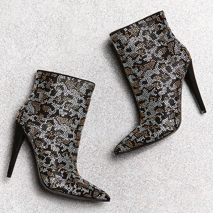 A pointed-toe bootie with a stiletto heel and inner zipper closure