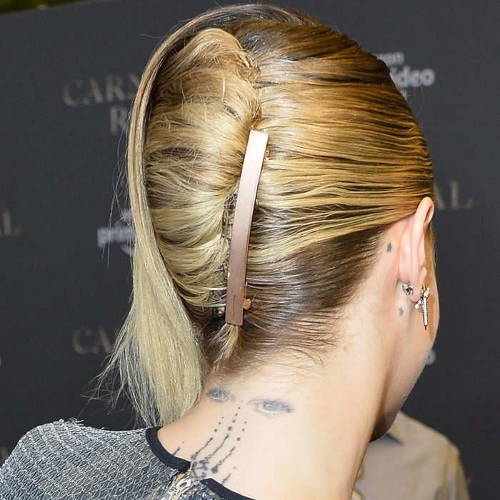Cara Delevingne's spooky eyes neck tattoo and star tattoos behind her ears