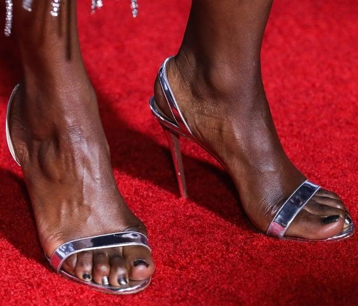Danai Gurira's sexy feet in So Nude 105 metallic leather slingback sandals