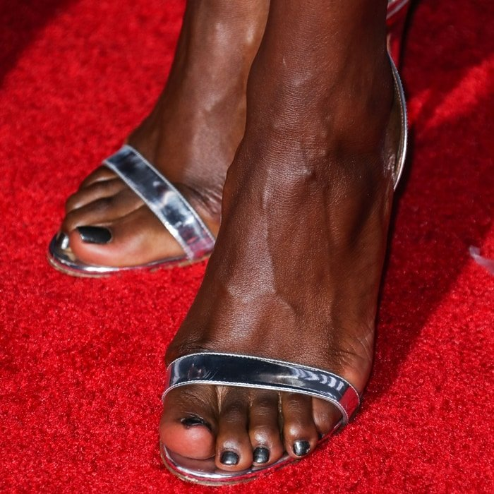 Danai Gurira displayed her toes in mirrored silver leather sandals with two simple straps