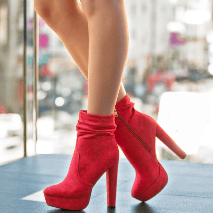 A slouchy platform bootie with a block heel and zipper closure