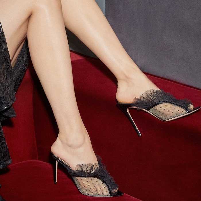 Add Gianvito Rossi's black Ofelia mules to your evening shoe offering, letting the polka-dot tulle upper lend an alluring finish to occasion edits