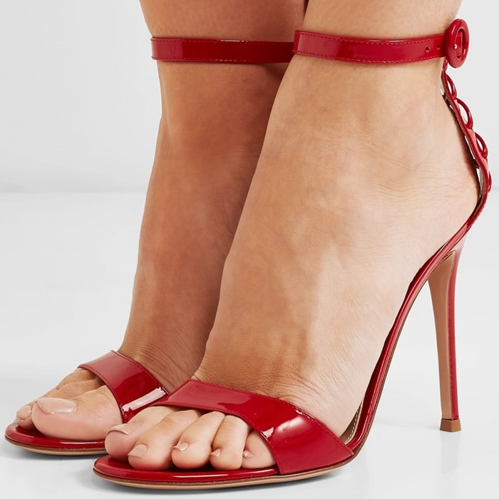 These red sandals are crafted from patent-leather and have a lace-up back inspired by corsets