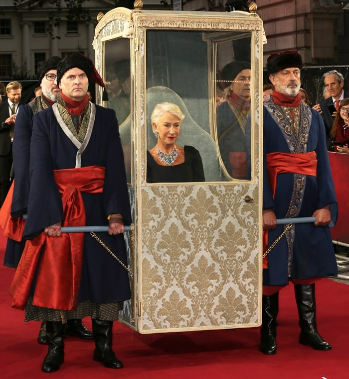 Dame Helen Mirren was carried by four guards in a gold sedan chair