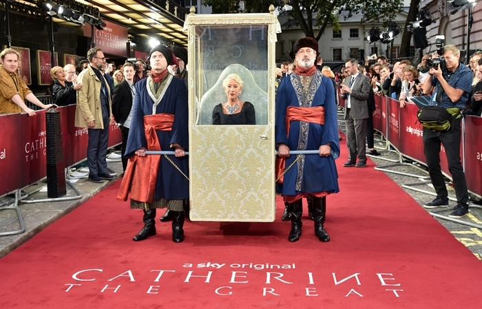 Dame Helen Mirren was carried onto the red carpet in a litter vehicle