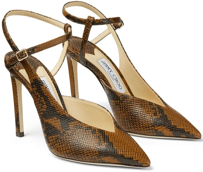 Jimmy Choo's tan python-effect leather Sakeya pumps underpin the label's elegant silhouettes