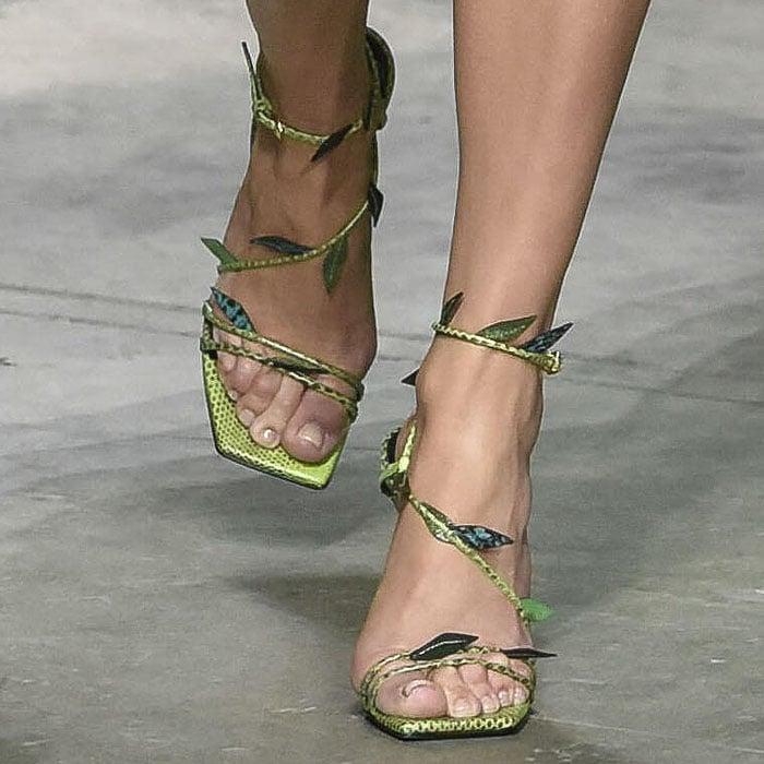 Jennifer Lopez's feet in strappy, leafy green-snake sandals