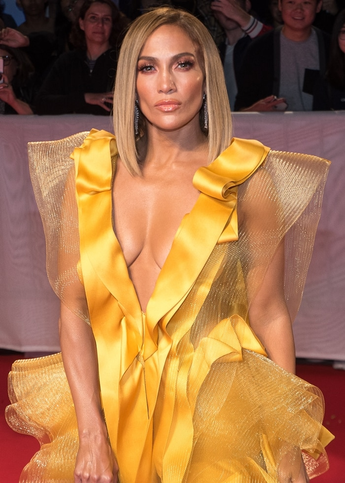 Jennifer Lopez donned a gold Maison Yeya Fall-Winter 2019 gown