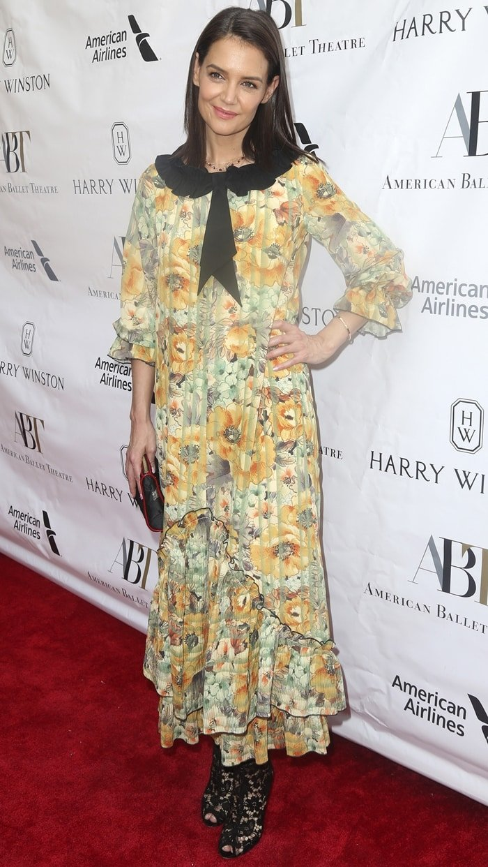 Katie Holmes styled a floral dress by Maison Mayle with black Dolce & Gabbana floral lace booties