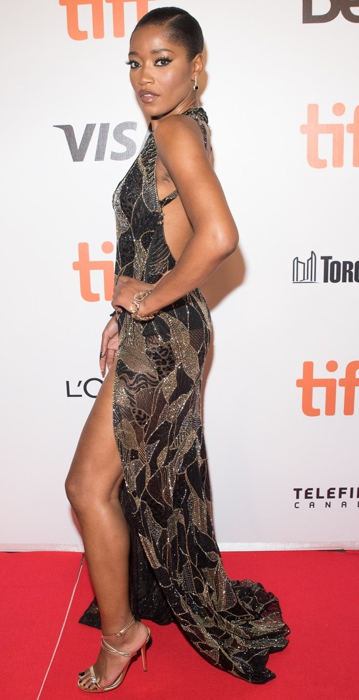 Keke Palmer strikes a pose on the red carpet at the Hustlers premiere at the Roy Thomson Hall in Toronto