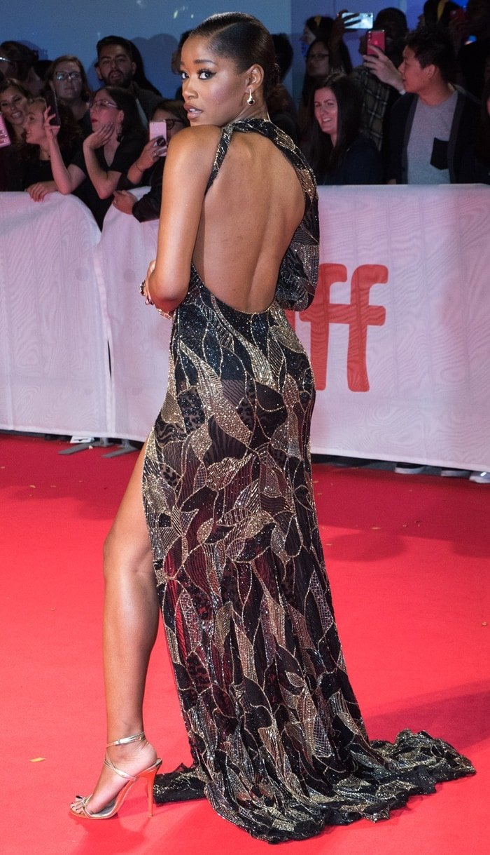 Keke Palmer flashes some leg in a glamorous dress
