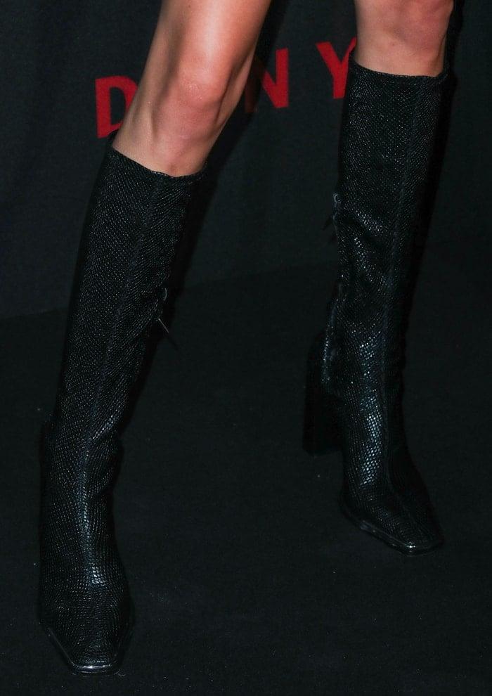 Kendall Jenner's snake-embossed knee-high boots