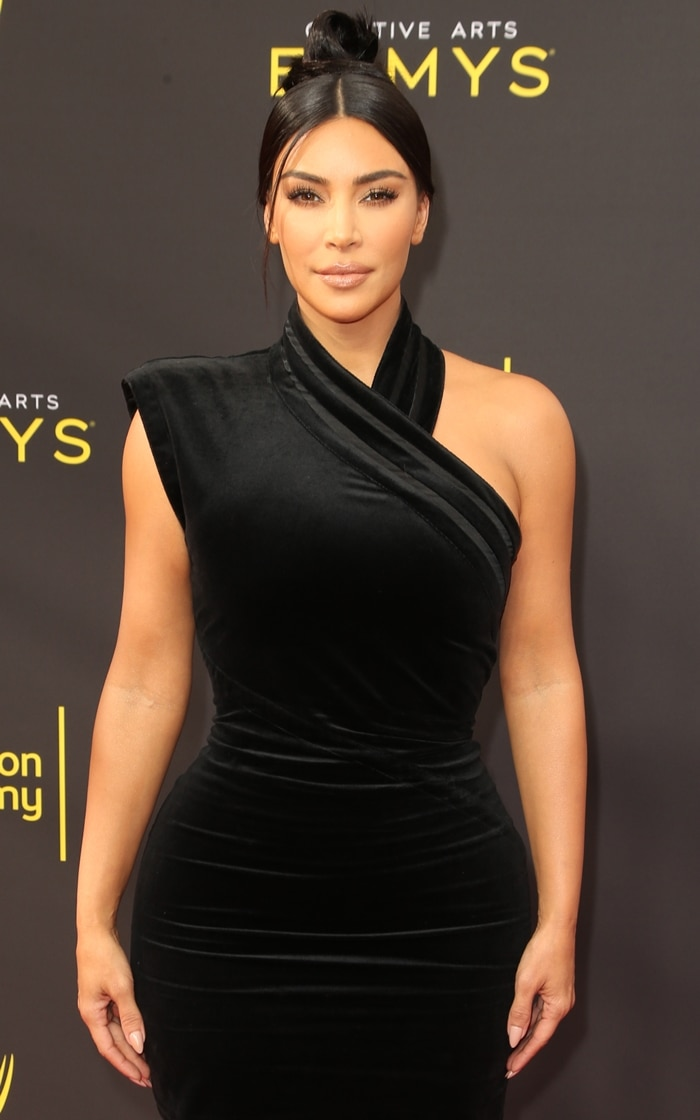 Kim Kardashian flaunted her curves in a sexy black dress