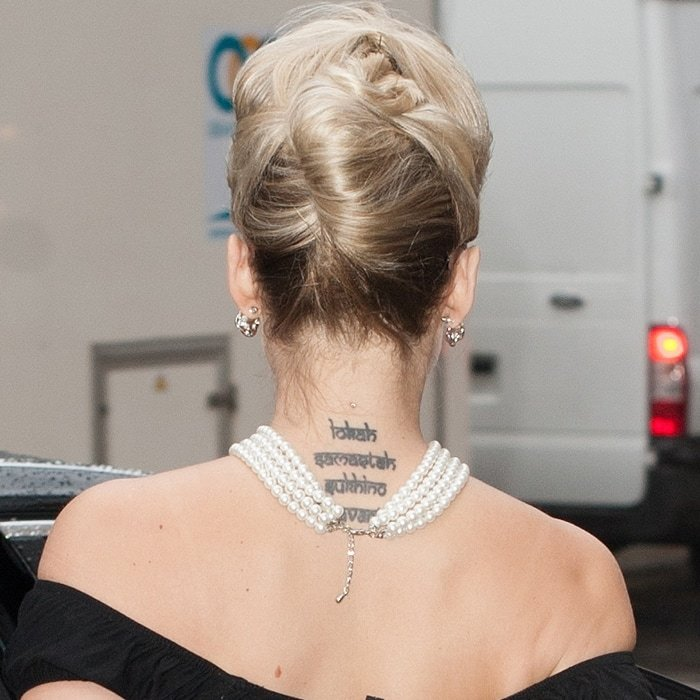 Kimberly Wyatt's religious Sanskrit neck tattoo