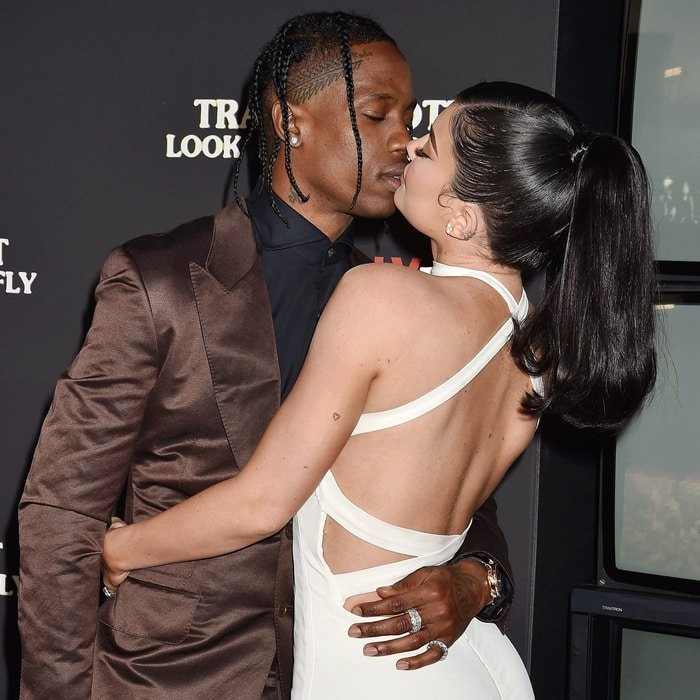 Travis Scott and Kylie Jenner kissing at the premiere of his documentary