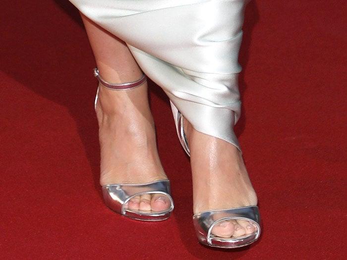 Kylie Minogue's sexy feet in her trusty silver Dolce & Gabbana sandals