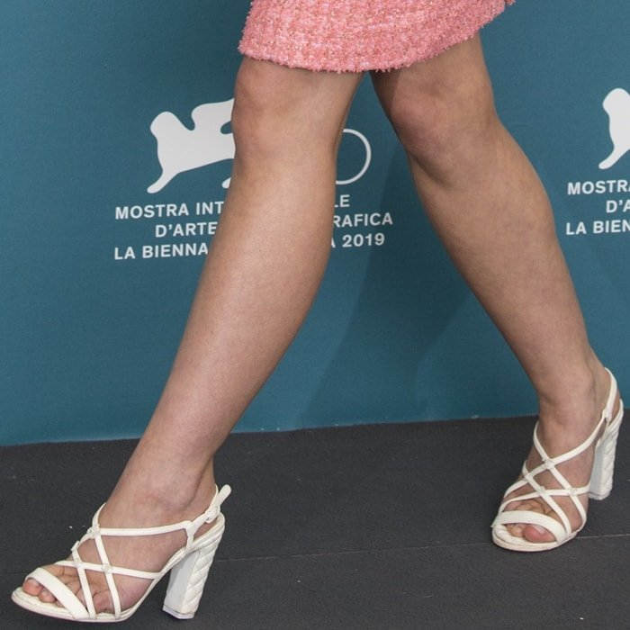 Lily-Rose Depp's sexy feet in white quilted sandals with chunky heels