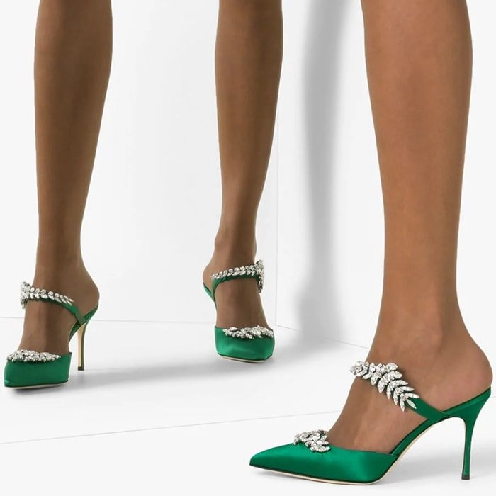 Sparkling crystal leaves vine across the strap and vamp of this pointy-toe pump, demonstrating Manolo Blahnik's flair for dramatic embellishment