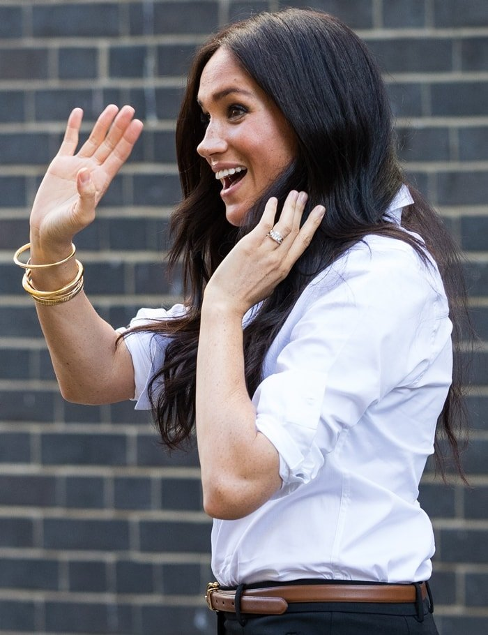 Meghan Markle wears a stack of gold bangles and cuffs on her right arm