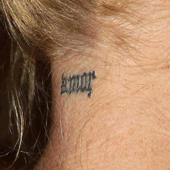 Melanie Griffith's Amor neck tattoo
