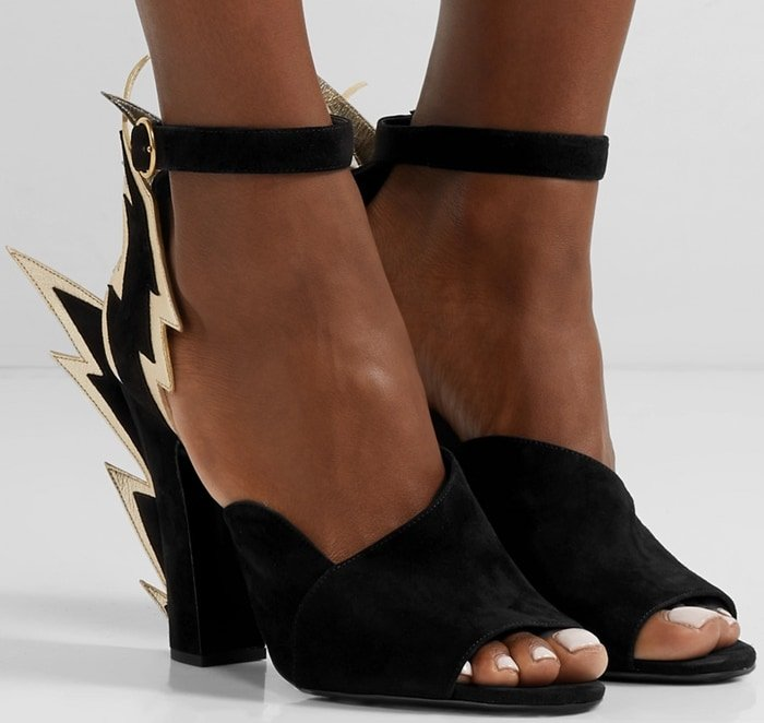 Lightning strikes three times, bringing electrifying energy to an ankle-strap pump made from suede and featuring a peep toe and curvy, notched vamp