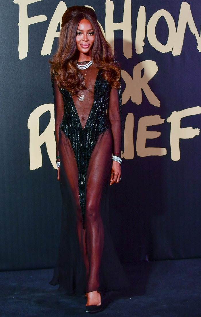 Naomi Campbell undressed for a good cause with a 1960-style bouffant
