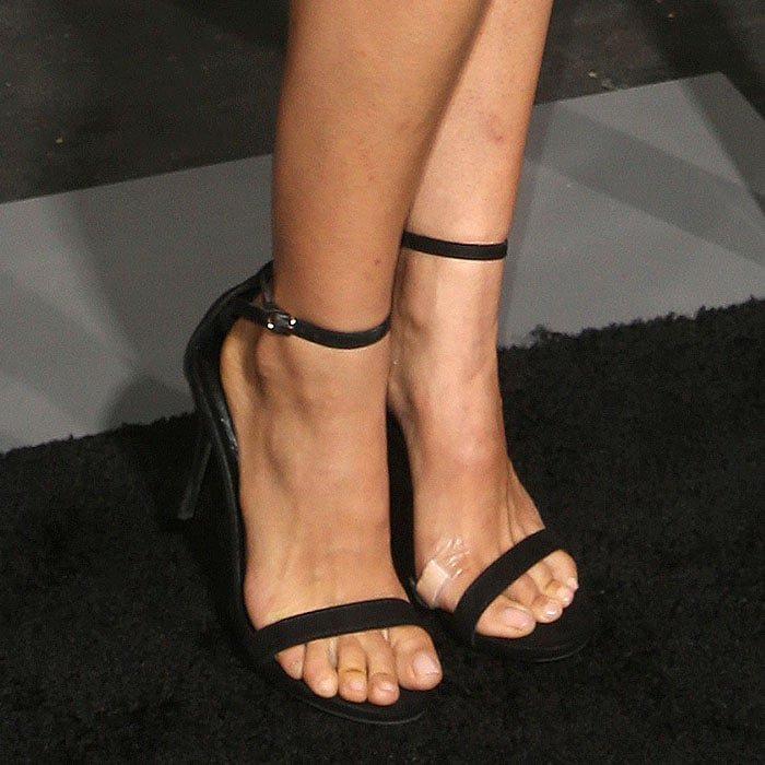 Natalie Portman with a band-aid on her feet