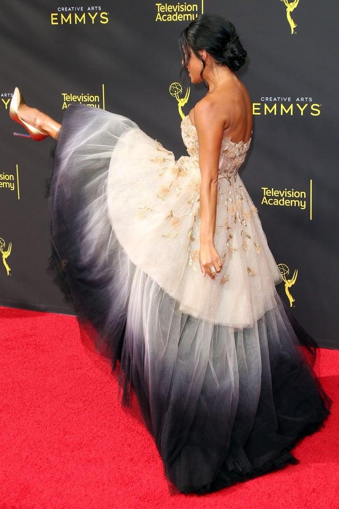 Nicole Scherzinger kicking up her gold heels