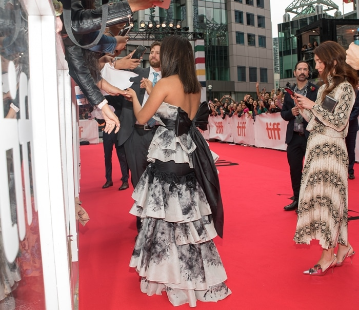 Priyanka Chopra's silk gown is designed with origami-inspired ruffles and accented with a large bow at the back