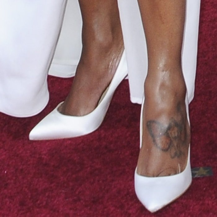 Regina King's foot tattoo of a woman with butterfly wings