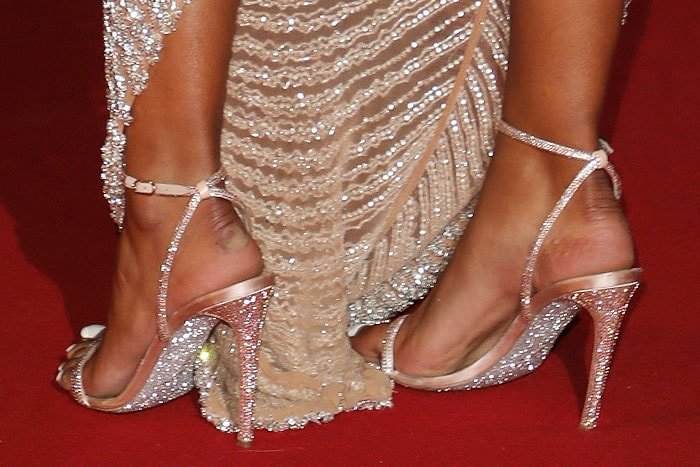 Maya Jama's hot feet in Rene Caovilla 'Ellabrita' sandals with glittery soles
