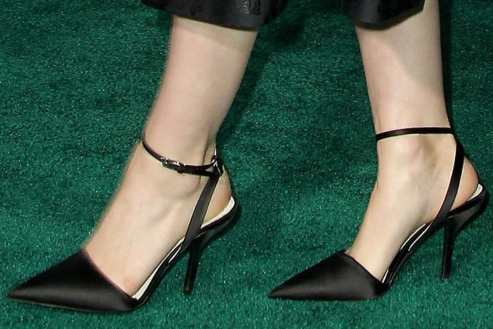 Rooney Mara's feet in black-satin pointy-toe ankle-strap pumps