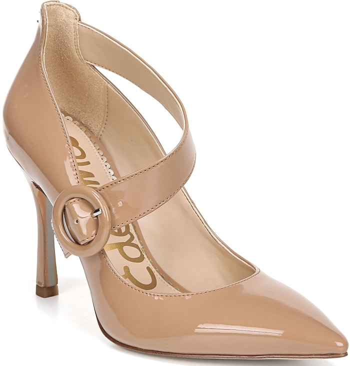 A curvy cross-strap buckle wraps the side of a sharp pointy-toe pump lifted by a slim hourglass heel