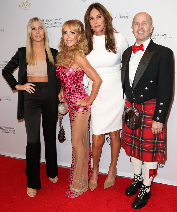 Caitlyn Jenner and Sophia Hutchins posing with Deborah Alessi and Dr. David Alessi, the founders of Face Forward